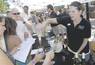 Melissa Yester of Loudoun Valley Vineyards, pours samples of wines for attendees of the 20th Annual Labor Day Jazz and Wine Festival held in Herndon on Labor Day 2008. Wineries from around the region provided the wine while several jazz bands provided the musical entertainment.