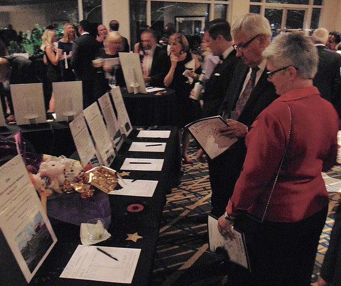 Guests check out the silent auction items during the Arc of Northern Virginia's Motown Experience Gala on Saturday, Oct. 22, 2016, at the McLean Hilton in Tysons Corner.