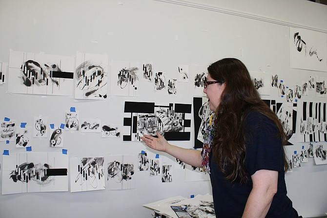 Painting a song is what Workhouse artist Britt Conley practices.