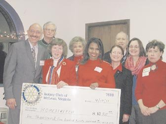 From left: Christopher Fay, Executive Director of Homestretch; Gerry Hamilton of Vienna; Jan Auerbach of McLean; Carolyn Chappell of Fairfax; Ingrid Parris-Hicklin of Tysons; Lynn Heinrichs of McLean; Chuck Pascoe of Burke; Susan Lydick of Bailey's Crossroads; and Diane Hill of Falls Church. The Rotary clubs of Alexandria, Rosslyn/Fort Myer, and Reston representatives are not pictured.