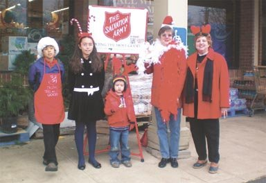 Salvation Army singers serenade Great Falls shoppers.