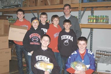 Volunteering at Food for Others on Wednesday, Dec 14, the Vienna Bombers 13U Travel Baseball Team sorted a variety of foods into bags to be distribution-ready for clients.
