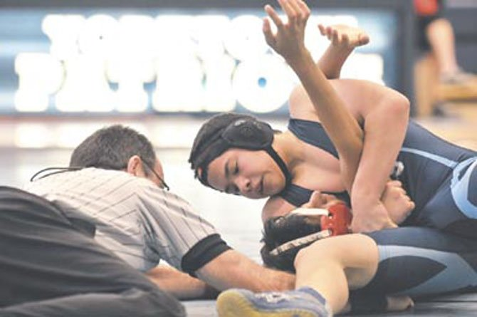 Yorktown freshman Rene Fuentes competes against Herndon on Jan. 14. Fuentes received the team&#39;s outstanding wrestler award for the meet. The Patriots won, 45-22.