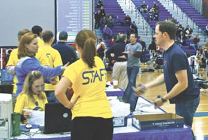 Volunteer staff members are seen working at the 26th Annual MidAtlantic Erg Sprints, which was held on Jan. 29, 2011 at the Gerry Bertier Gymnasium at T.C. Williams High School.