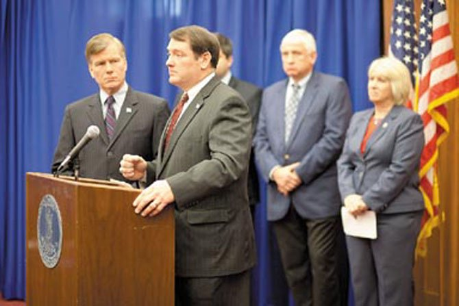 "Governor Bob McDonnell (left) listens as Springfield Supervisor Pat Herrity comments on legislation to reduce ""unnecessary"" mandates on localities during a news conference in Richmond Monday, Jan. 16."