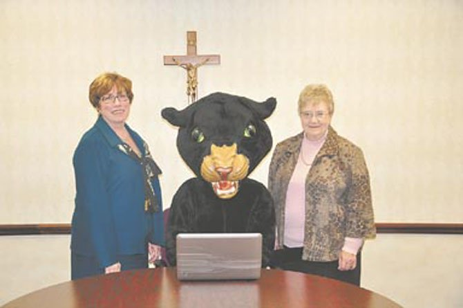 Signaling the launch of Paul VI's new school-wide laptop program are (from left) Principal Ginny Colwell, the PVI panther mascot and Sister Bernadette McManigal, superintendent of Catholic Schools for the Arlington Diocese.