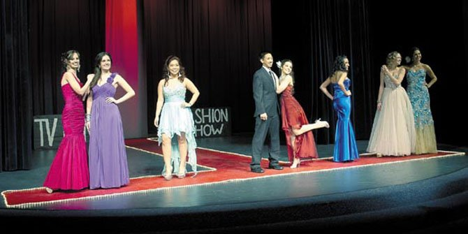 "Robinson Secondary School students glam it up during the Jan. 11 DECA Fashion Show organized and run by students. Looks in the show were organized into scenes from popular television shows.  This final scene was from ""The Bachelor."" Pictured here (in no particular order): Jana Abutayeh, Hayley Aguayo, Mora Azez, Katie Jones, Charlie Nguyen, Rachel Thomas, Sarah Thompson."