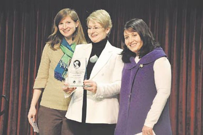 From left, Mandy Guernsey, Gillian Sescoe and Abby Kimble. Guernsey and Kimble, of Reston Interfaith, presented Sescoe with the 2012 Dr. Martin Luther King Jr. community service award at the Reston Community Center Monday, Jan. 16.