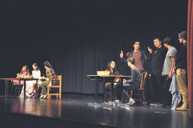 "Langley students play the various parts of a man and woman's subconscious in the one-act play ""Reservations."" Langley presented 10 different one act plays last weekend, which were all student-directed."