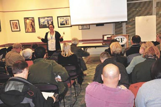 Pfc. Katy Defoe, Crime Prevention Officer for the Fairfax County Police Reston District Station, speaks to Great Falls homeowners representatives at the Great Falls Library Tuesday, Jan. 10.