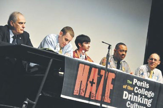 From left, Jeff Levy, president of Virginia College Parents, Casey Lingan of the Commonwealth's Attorney, Ryan Smith, a graduate student at Virginia Tech, Capt. Bruce Ferguson, commander of Fairfax County Police Youth Services Division and Dr. William Hauda, emergency physician, members of a panel discussion on college drinking at McLean High School Wednesday, Jan. 11.