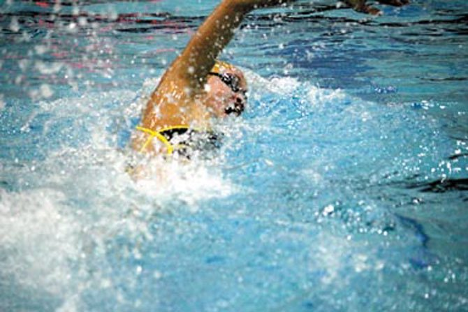 Janet Hu competes in the 200-free event during Oakton&#39;s victory over Chantilly. 
