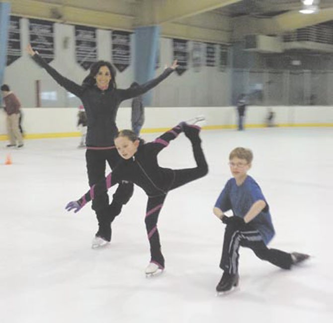 Emme Porter and her students Ava Dempster, 8, and Griffin Sendek, 12, enjoy the ice. The Mt. Vernon RECenter has made a commitment to provide ice time for diverse activities including hockey, free skate, and public sessions.