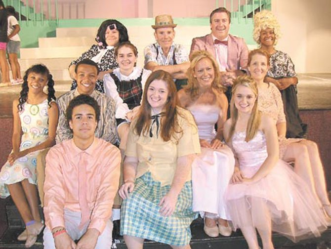 "Back row, from left, are ""Hairspray"" cast members Joe Philipoom, Mike Cash, Michael Clendenin and Taylor Young; in middle, from left, are Madeline DeFreece, Chaz Coffin, Amanda Mason, Cathy Arnold and Ellen Woodstock; and front row, from left, are Cole Smith, Brittany Washington and Taylin Frame."