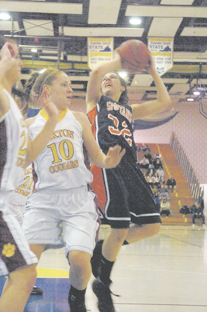 The Coyer twins, Caroline and Katherine, make up the best backcourt in the Northern Region. Pictured here is Katherine (10), who is averaging over 14 points per game this season.