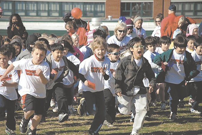 "More than 600 Marshall Road students – kindergartners through sixth graders – participated in the Run-a-Thon on Nov. 18, 2011, also known as ""Trotting for a Track."" Marshall Road PTA raised almost $25,000 in support of its initiative to build a new school track."