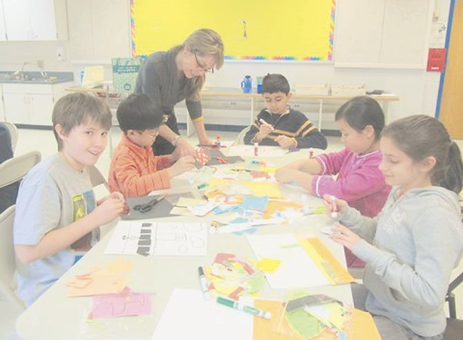 Churchill Road fourth graders get tips on how to make a collage expressing some aspect of their lives from Sharon Fishel of McLean Project for the Arts. Pictured from left to right are Jack Greehan, Kwanwoo Park, Sharon Fishel, Armin Bagha, Zoe Gomez-So and Sydney Bamdad.