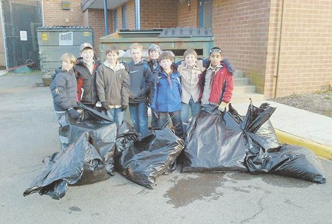 Webelo Pack #665 members pose with the bags of debris that they collected from the Churchill Road School grounds. From left to right are Walker Haynes, Gabriel Wimmer, Drew Myers, Cole Stitt, Ethan O'Donovan, Connor Graves, Chris Barre and Zubair Choudhury.