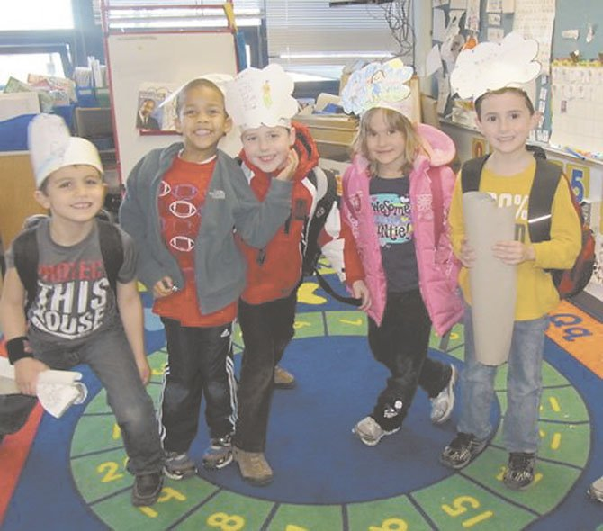 "Churchill Road kindergartners in Jan Clark's class show off the ""I have a dream"" hats that they created as part of their study of Martin Luther King, Jr. From left to right are: Noah Golesorkhi, William Wynne, Christopher Valko, Clara Stevens, and Quintin O'Kane."