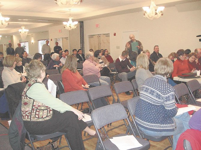 Local residents were invited to ask questions of speakers Chap Petersen and Mark Keam at the town hall meeting hosted by American Legion Post 180.