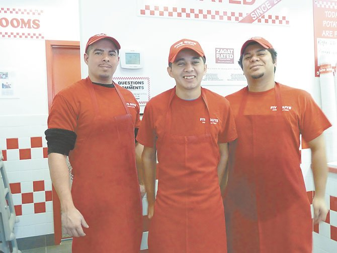 Christopher Sandoval, Pablo Escobar and Alex Guillen — some of the new staff at Five Guys.