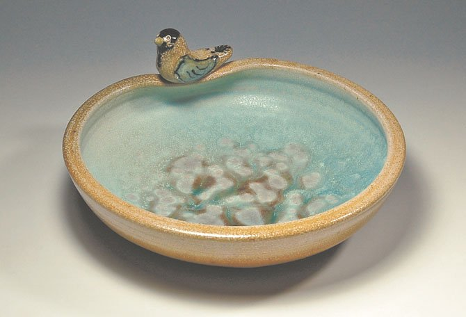 """Opening Dish with Bird,"" pottery by Marianne Cordyack."
