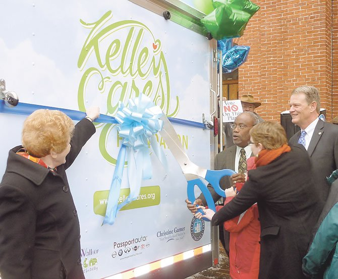 Councilwoman Del Pepper, Mayor Bill Euille and Vice Mayor Kerry Donley join Lindsay Swanson in cutting the ribbon to the new Kelley Cares Multi-Sensory Mobile Jan. 21 at City Hall.