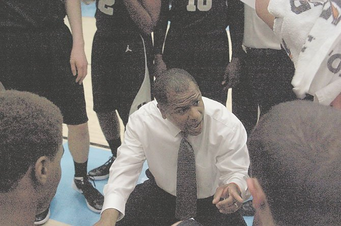 Westfield head coach Doug Ewell talks to his team during its game against Centreville.  