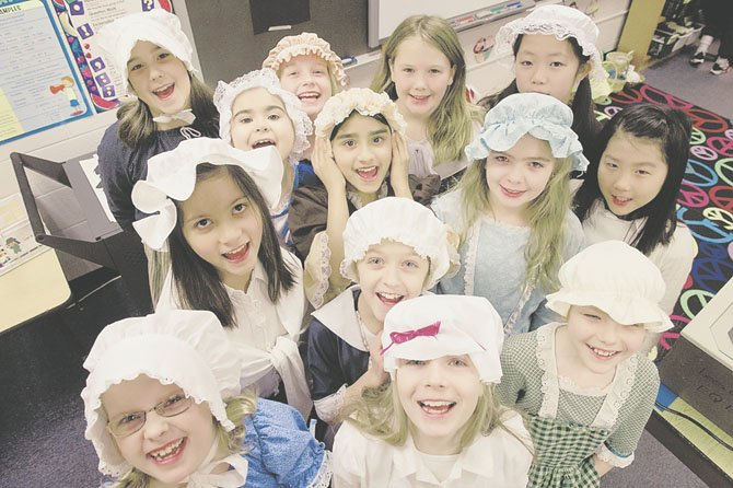 The girls in Lori Hilburger's fourth grade class show off their bonnets and colonial costumes.