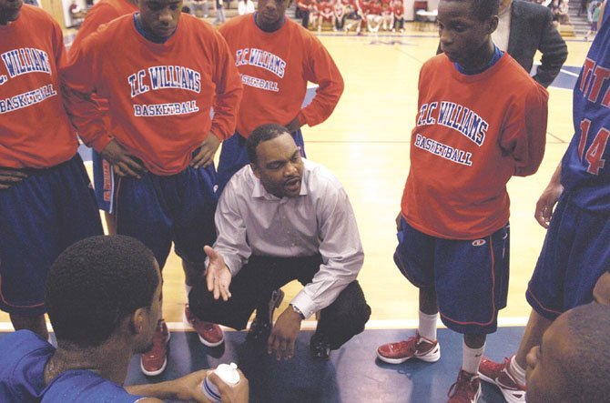 T.C. Williams boys basketball head coach Julian King talks to the Titans during a Jan. 24 contest at Woodson.