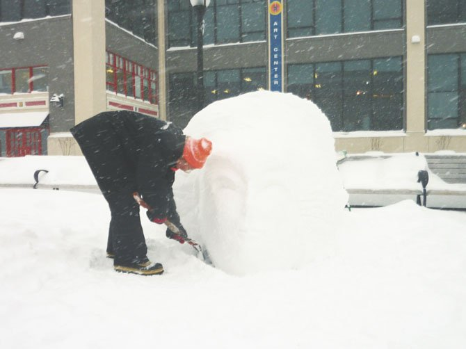 Torpedo Factory artist Tatyana Schremko takes advantage of one of last year's snow storms to make an ice sculpture.