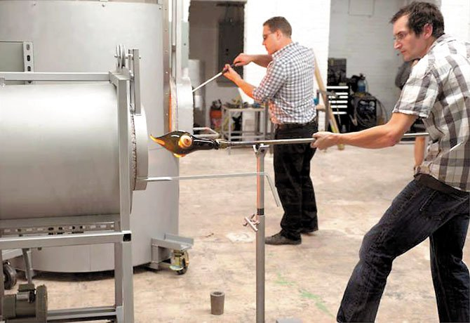 Students fire their glass-blown art in the new hot shop at the Lorton Workhouse Arts Center.