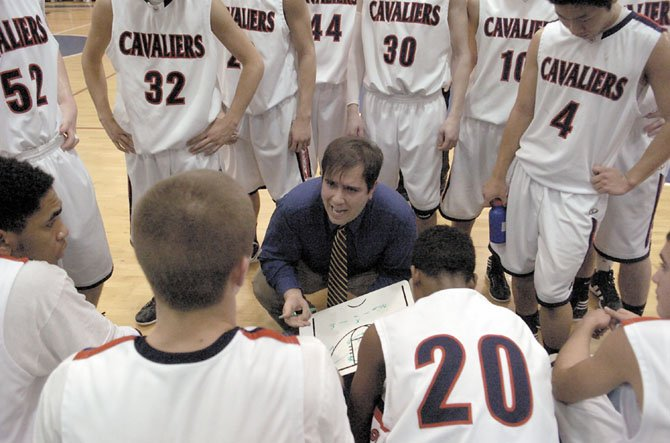 Woodson boys basketball head coach Doug Craig talks to the Cavaliers during a break in the action against T.C. Williams on Jan. 24.