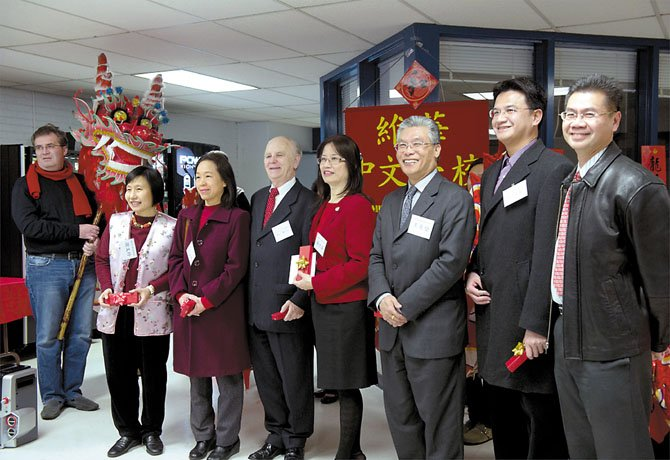 Officials from the Wei Hwa Chinese School celebrate the move of the school to West Springfield High School on January 22. From left: Parent Ken Concannon, Dr. Wenling Hsieh Lin, of the Association of Chinese Schools; Kerry Liou, of the Culture Center of the Taipei Economic and Cultural Representative Office; Marty Martin, CEO of the University of North America, he is also a school parent; Sheree Tasai, principal of the school; Jeffrey Wang, Director, and Jeff Liu, Executive Officer of the Consular Division of the Taipei Economic and Cultural Representative Office, and Jason Tsai, a school volunteer and parent.