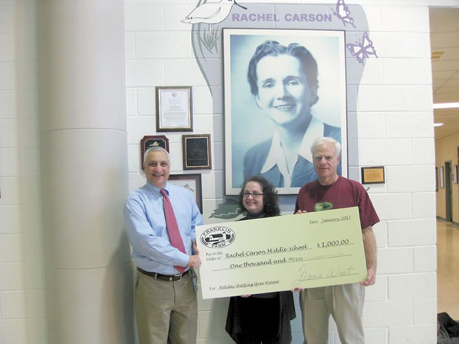 From left: August Frattali, principal of Rachel Carson Middle School; Sandra Davis, holiday shopping spree winner, and John Solomita, owner of Subway.