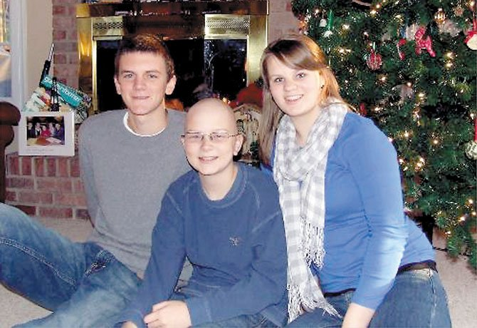 From left: Siblings Michael, Andrew and Sara McCaffrey during Christmas 2011.