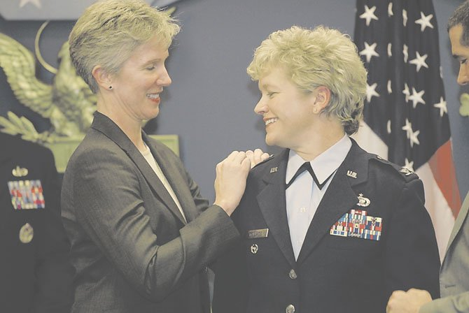 Kathy Knopf, left, pins colonel's wings on her partner, Air force Col. Ginger Wallace, during Wallace's December 2011 promotion ceremony in the Pentagon's Hall of Heroes. Wallace and Knopf, who live in McLean, attended the State of the Union last week and sat in the first lady's box.