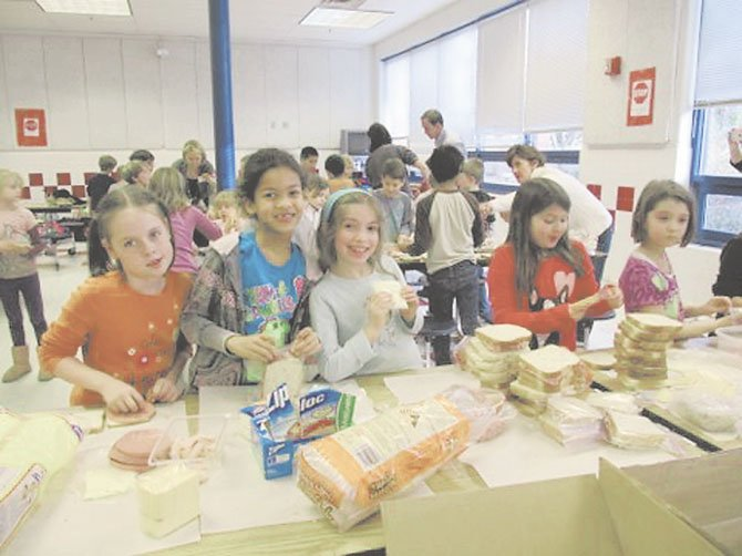Churchill Road second graders Mackenzie Wicker, Nicole Wynne, Catherine Zavela, Marin Heberlig and Chloe Counts make sandwiches for Martha's Table in Washington, D.C.