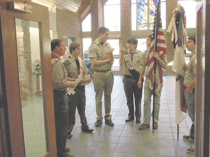 Nate Webber, Braeden Sebastian, and Gus Newton, with Scoutmaster Thomas Kiess and color guard before the Eagle Scout award ceremony.