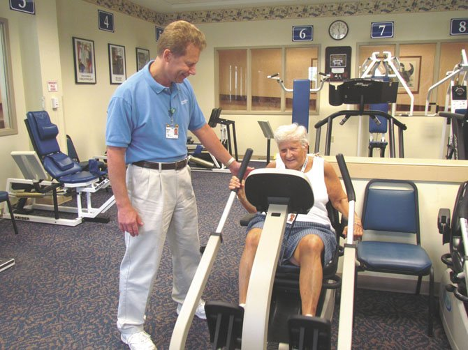 Fitness expert Brad Hibbs of Greenspring, a retirement community in Springfield (shown here with Greenspring resident Julia Gerow), says motivating seniors can be challenging.  