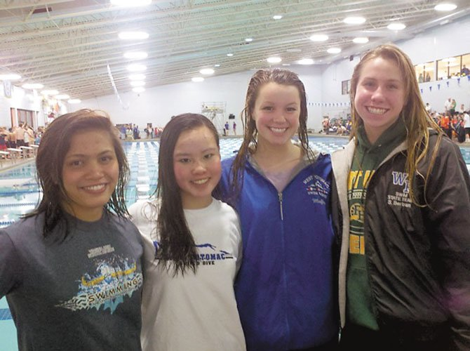 The West Potomac girls' 200Y medley and 400Y freestyle relay teams placed first in both events at the Patriot District meet on Jan. 28. Senior Reanna Dona, junior Hellen Moffitt, sophomore Sara Bertram and freshman Maxine Clifford teamed up to set a new Patriot District record (1:47.02) in the girls' 200 medley relay and won the 400 freestyle relay (3:37.51) by nearly four seconds. All three West Potomac girls' relay teams will advance to the Northern Region meet and the Virginia state high school championship meet in February.