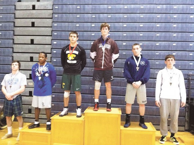 Mount Vernon senior Dusty Floyd, middle, placed first in the 170-pound weight class at the Ocean Lakes Invitational on Jan. 27-28. Floyd became Mount Vernon's all-time leader in wrestling victories on Jan. 25 when he earned win No. 148.