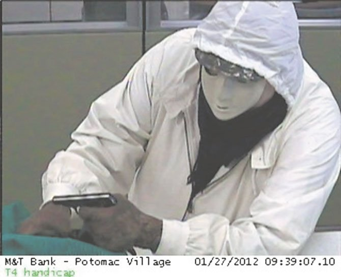 Police released this photo of a suspect in the robbery of the M&T Bank Friday morning Jan. 27. The suspect carried a black handgun and umbrella, according to police reports.