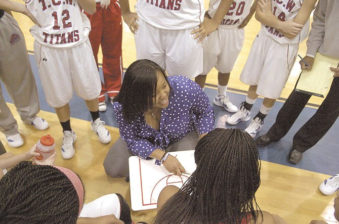 T.C. Williams girls basketball coach Kesha Walton talks to the Titans during a game against West Springfield on Jan. 30 at The Garden.