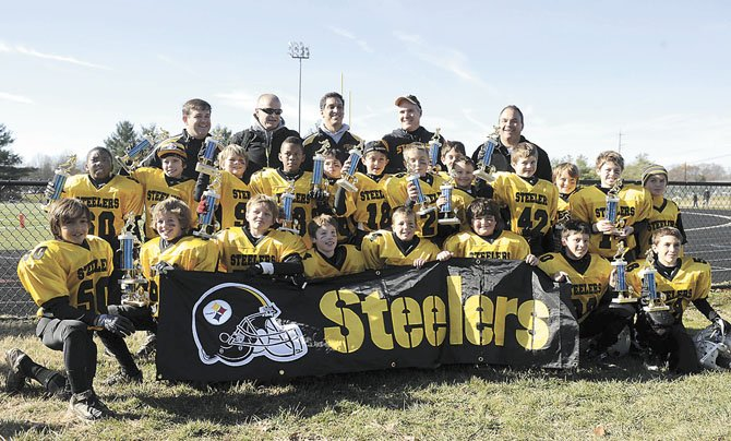 Dave Humiston's football team wins the championship Superbowl, played at Bullis School on Saturday, November 19, 2011, in Potomac, MD.  (Photo by Leslie E. Kossoff/LK Photos)..