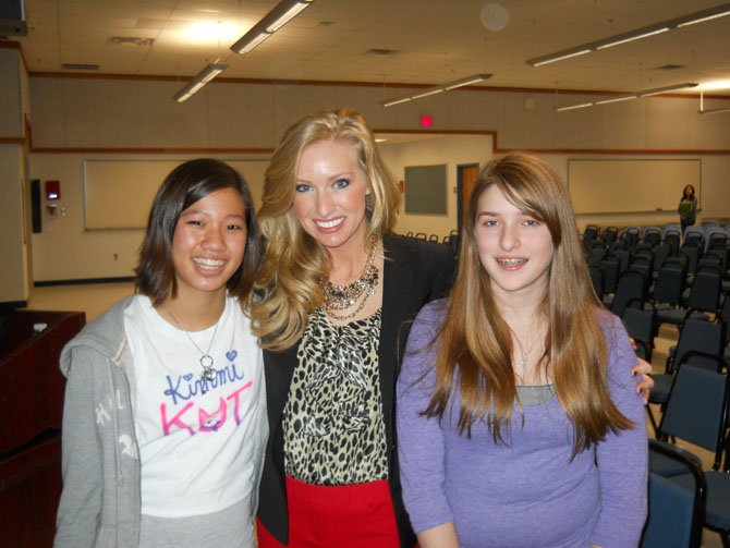 Seventh graders, Kim Schwadron, left, and Emily Swatt, right, were inspired by Miss Virginia's message.