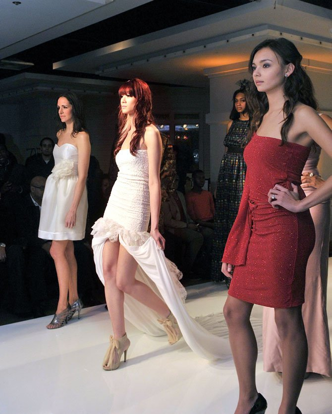 Cindy Nguyen walks the runway during the press preview of the 2012 Crystal Couture on Monday evening, Feb. 6.