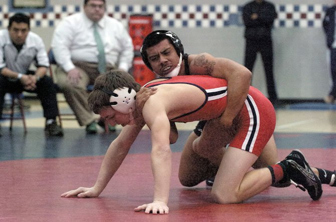 Wakefield senior Henry Majano, top, wrestles Edisons Brock Jacobson in the 132-pound National District final on Feb. 4 at Stuart High School.