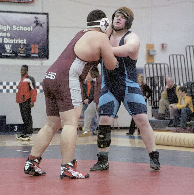 Yorktown's Charlie Whelden, right, won the National District championship in the heavyweight division on Feb. 4 at Stuart High School.