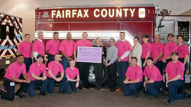 Fire Chief Ronald Mastin of the Fairfax County Fire and Rescue Department presented a check for $2,000 to Liz Davey, the American Cancer Society's Vice President on Jan. 30, for the fight against breast cancer.